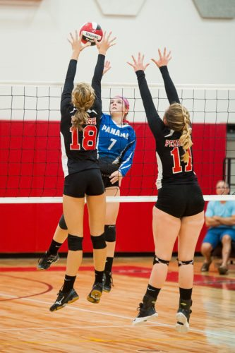Panama's Madalyn Bowen (7) meets Maple Grove's Maddie Welsh (18) and  Olivia Pembridge (11) at the net during Monday's South Division volleyball match at Maple Grove Junior-Senior High School. P-J photo by Valory S. Isaacson