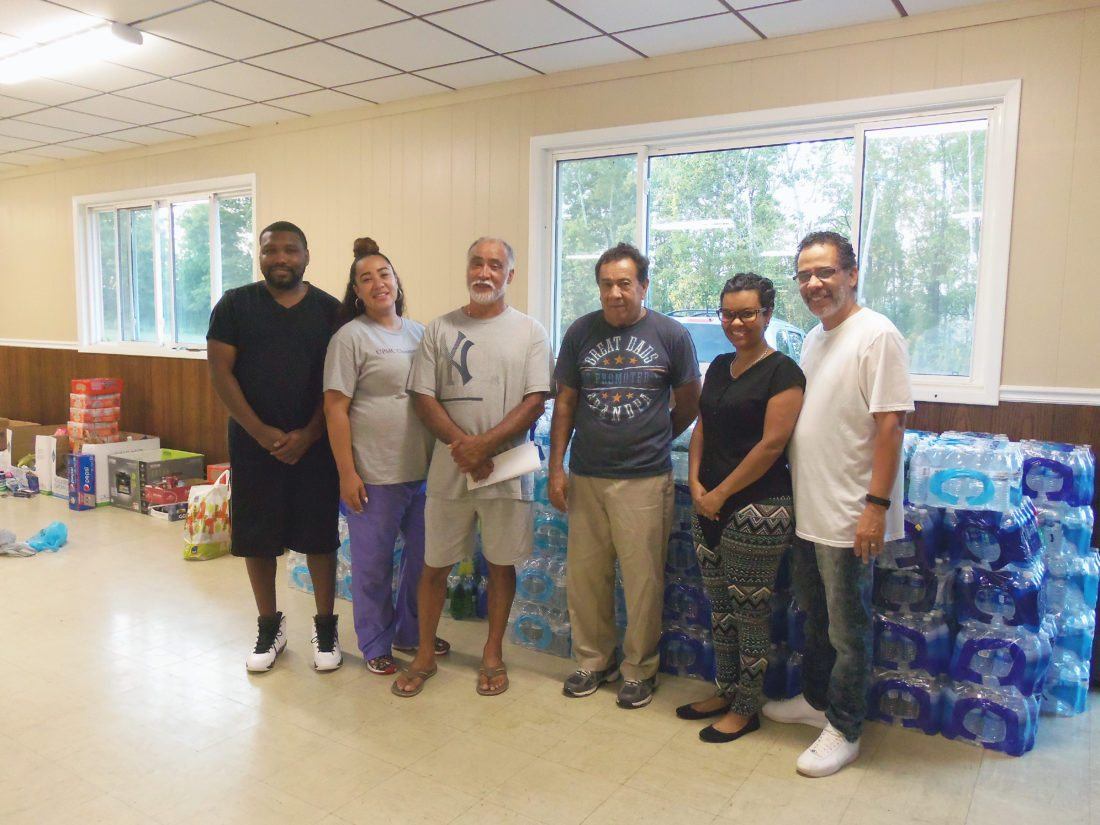 A local man has organized a collection point at the Morton Club for victims of Hurricane Maria in Puerto Rico. Pictured from left are: Freddie Holmes, Vidalys Colon, Videl Colon, Jose Pina, the Rev. Ana Correa and Miguel Correa. P-J photo by Katrina Fuller