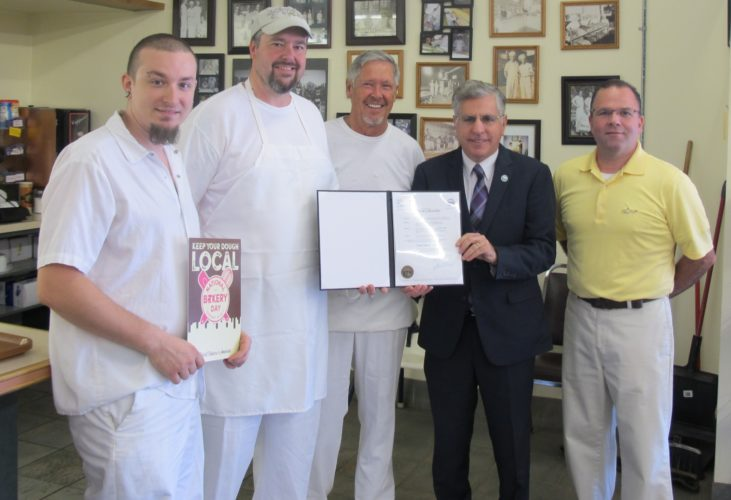From left, Nick Marchini, Farm Fresh Foods baker; Chad Ecklof, Ecklof Bakery baker and cake decorator; Rick Ecklof, Ecklof Bakery certified master baker; Sam Teresi, Jamestown mayor, and Bob Tilaro, Tilaro's Bakery president; at Ecklof Bakery, located at 832 Foote Ave., to recognize National Bakery Day, which is today. Teresi presented a proclamation to the bakers Wednesday declaring it Local Bakery Day in Jamestown today. P-J photo by Dennis Phillips