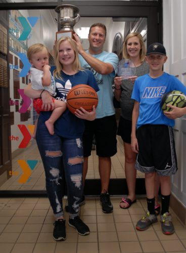 The Smith Family (in all their glory) pose for a picture in front of the Y's main interior door entrance, at the Jamestown Area YMCA's Downtown Branch, Sept. 27. The Smith Family was named YMCA Family of the Year at the Y's Annual Awards Banquet, held at the Y, Aug. 27.