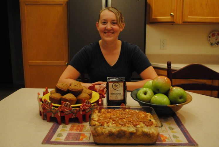 Kaitlyn Whalen looks over Apple Brown Betty and Applesauce Muffins she prepared from apples from Peterson Farm, where an apple tasting event takes place today from 11 a.m. to 3 p.m. Photos by Beverly Kehe-Rowland