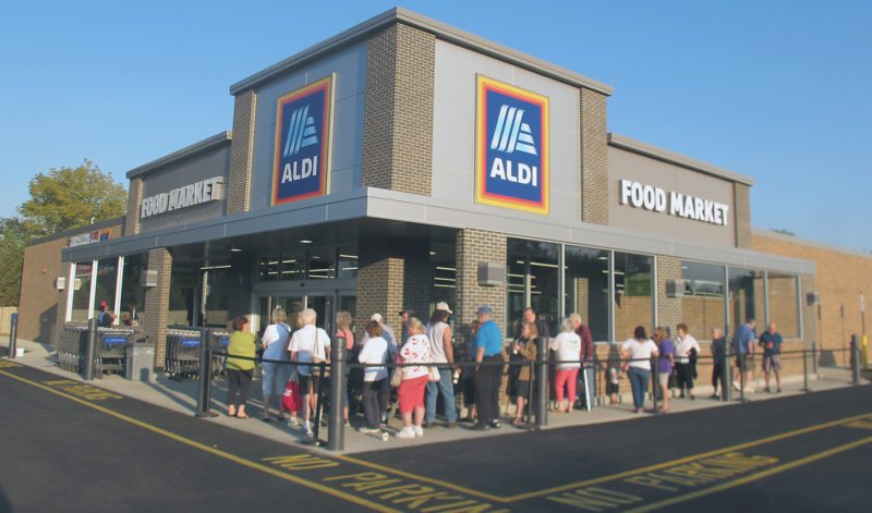 "ALDI's Jamestown location at 930 Fairmount Ave. reopened its doors Wednesday following a monthlong remodel and expansion to the store. Customers were welcomed back and the first 100 through the doors received special ""golden tickets"" containing ALDI gift cards of varying amounts. P-J photo by Gavin Paterniti"