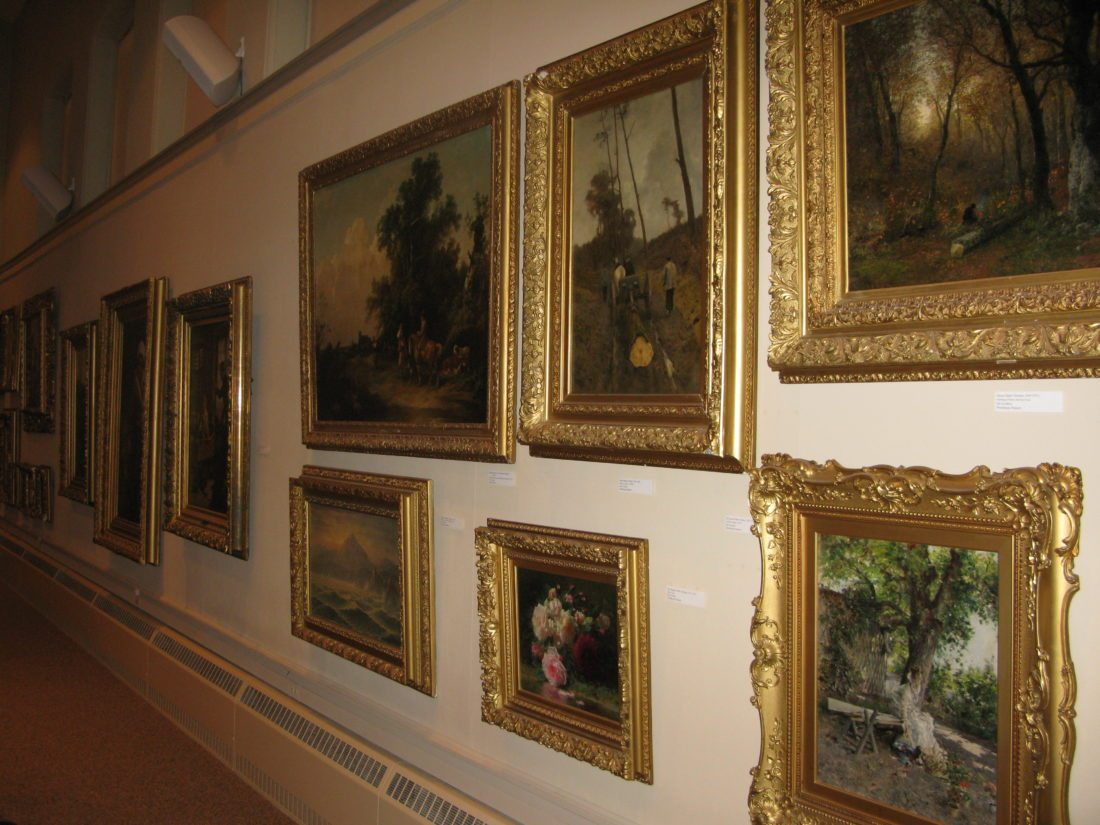 Pictured are oil paintings that used to hang in the Fireplace Room at the James Prendergast Library. Some of the paintings will be auctioned next week. P-J file photo by Gavin Paterniti