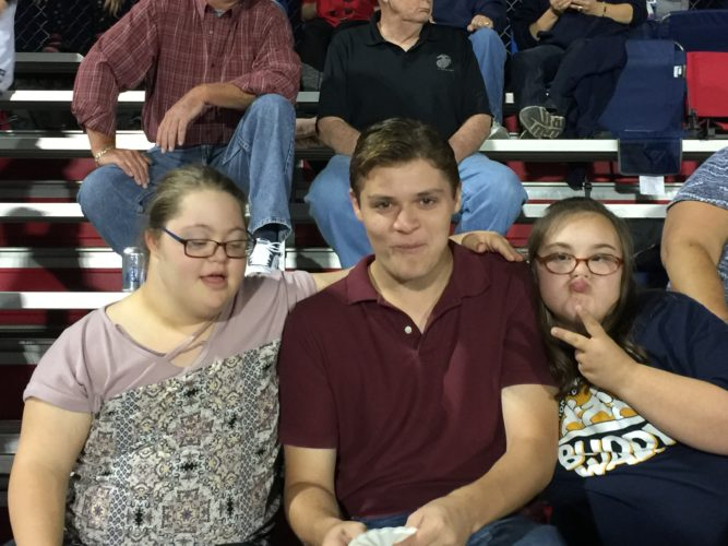 Sami Henry, left, and Abby Adam, far right, will be attending their first homecoming dance tonight. Their friend Chris Butler is pictured center. Submitted photo