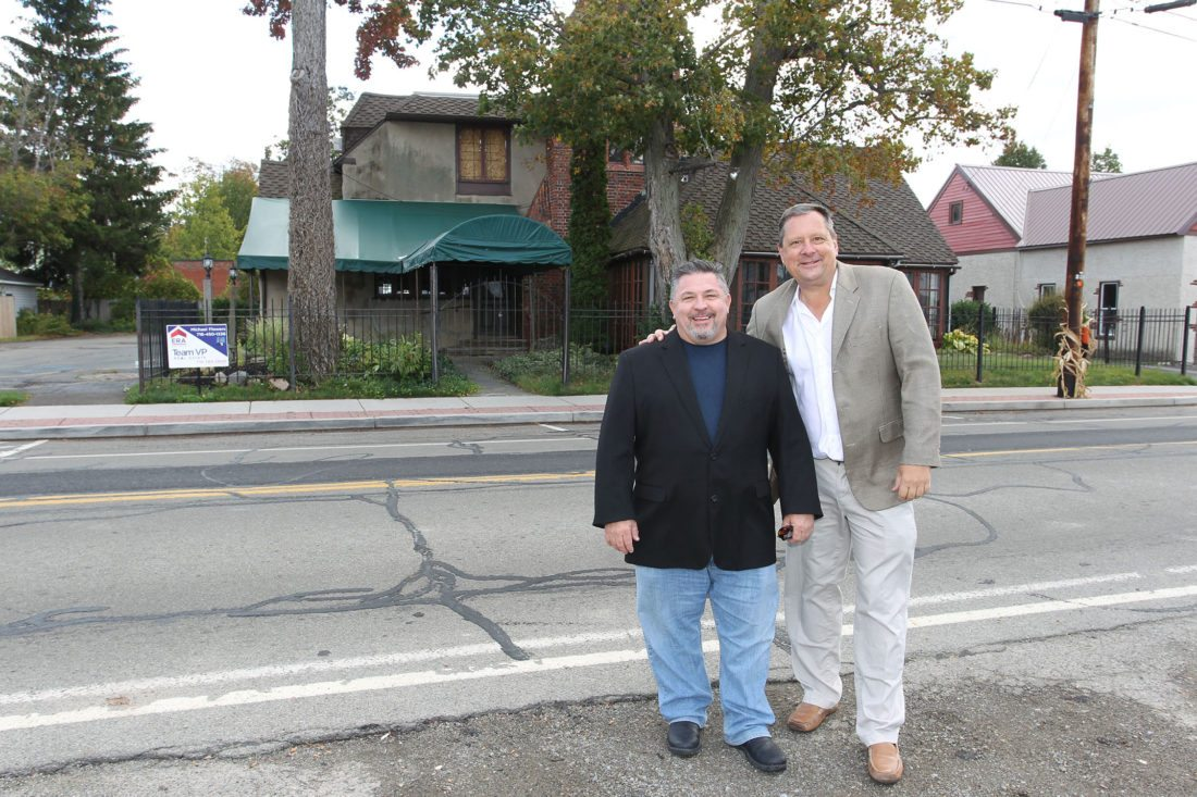 Robert Cusimano, left, and Chris Olsen outside the Ye Hare 'n Hounds Inn last week in Bemus Point. The longtime friends and 1982 graduates of Jamestown High School are in the final stages of purchasing the iconic fine-dining restaurant, which has been closed since a fire broke out in May.  Submitted photo