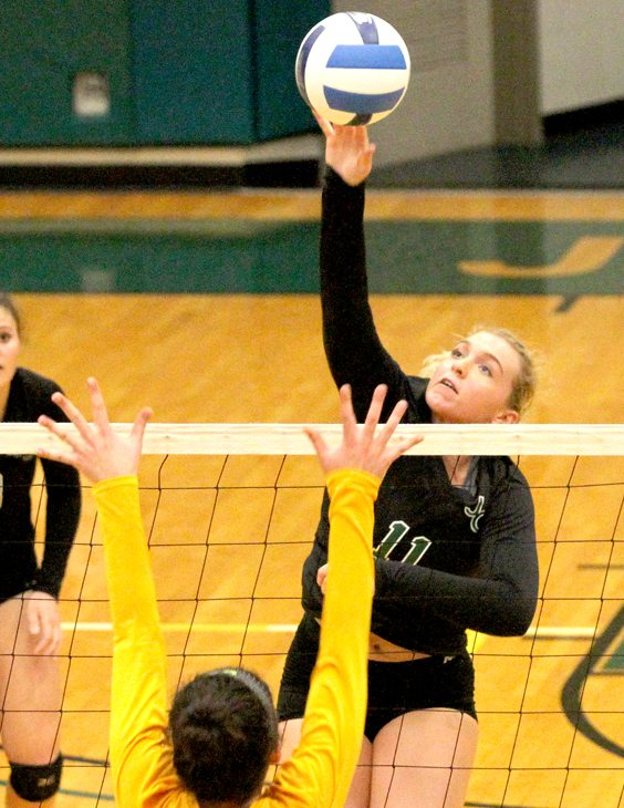 Jamestown Community College's Kendyl Austin puts down a spike during NJCAA Region 3 Division III volleyball action against Monroe CC on Tuesday at the Physical Education Complex. P-J photo by Lisa Monacelli
