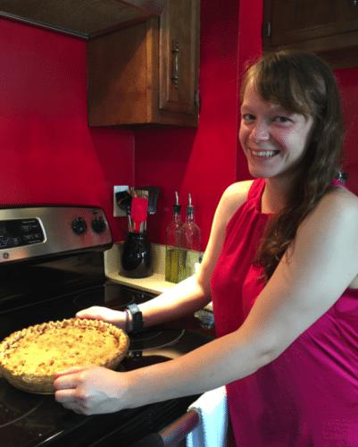 Sami Harrower takes an Apple Butter-Pumpkin Pie from the oven.
