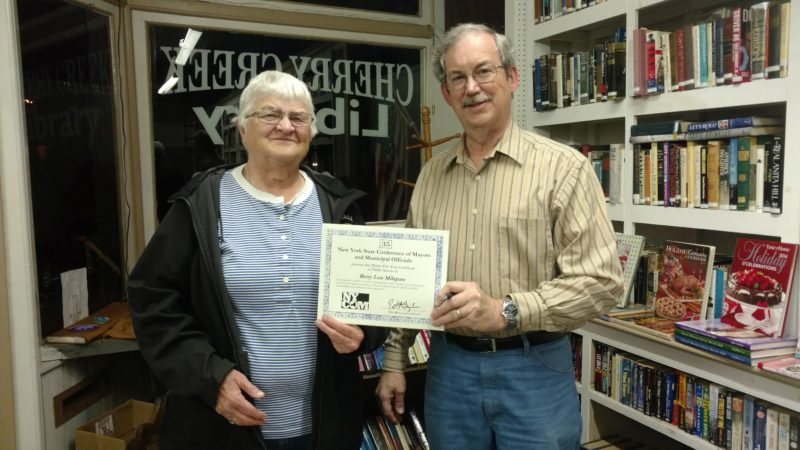 Betty Lou Milspaw is shown receiving a certificate of recognition upon performing over 35 years of service to the Village Board of Cherry Creek. Mayor Bruce Hendricks presented the award on behalf of the New York State Conference of Mayor's and Municipal Officials. P-J photo by Sue Ann Fish