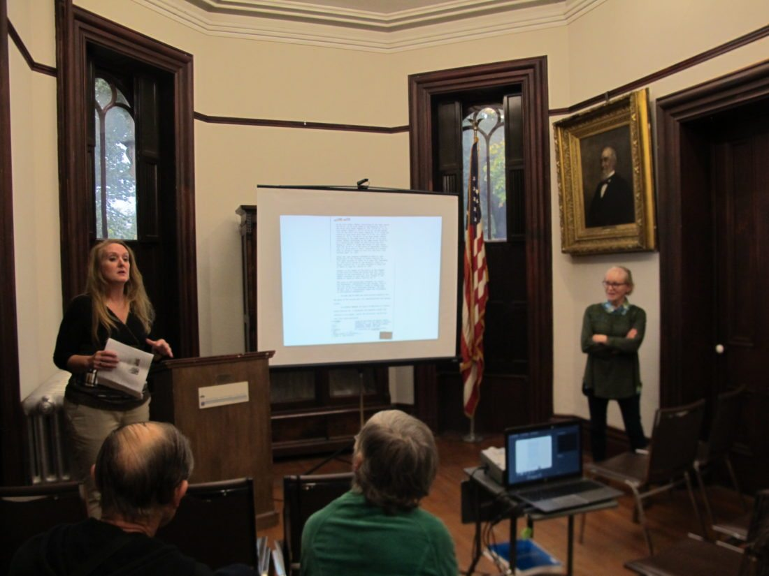Michelle Henry, Chautauqua County historian, left, and Wendy Straight, Chautauqua County Historic Structure Database volunteer, discuss the mission and progress of the online database during Wednesday's Brown Bag lecture at the Fenton History Center. P-J photo by Gavin Paterniti