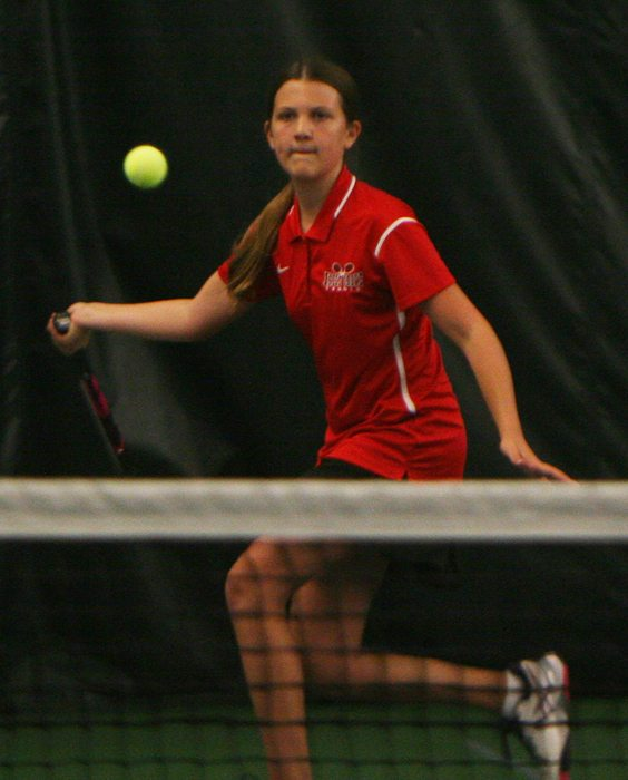 Maple Grove's Emma Collins lines up a shot at the CCAA tennis championship. P-J photo by Scott Kindberg