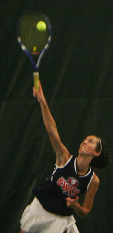 Southwestern's Mikayla Johnson strikes a serve at the CCAA tennis championship. P-J photo by Scott Kindberg