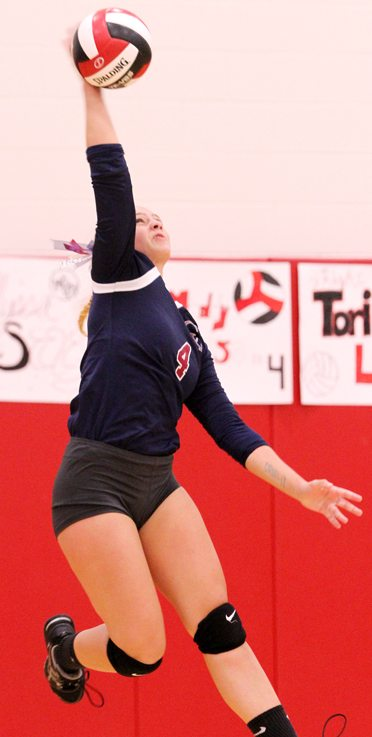 Chautauqua Lake's Olivia Anderson delivers a spike. P-J photo  by Lisa Monacelli