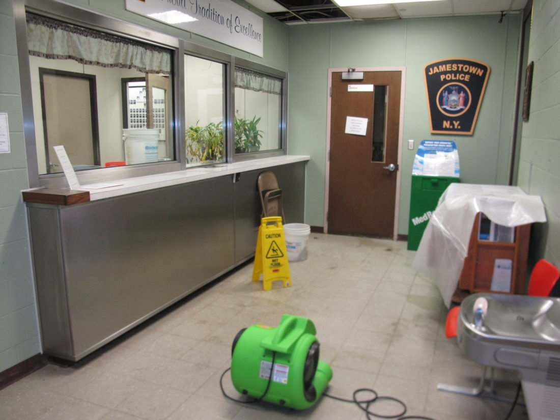 Work is still underway to repair damage caused by a water leak at Tracy Plaza in Jamestown. The city is in talks with the contractor to finish the work, which has forced the closure of the customer service entrance of the Jamestown Police Department for several weeks.  P-J photos by Gavin Paterniti