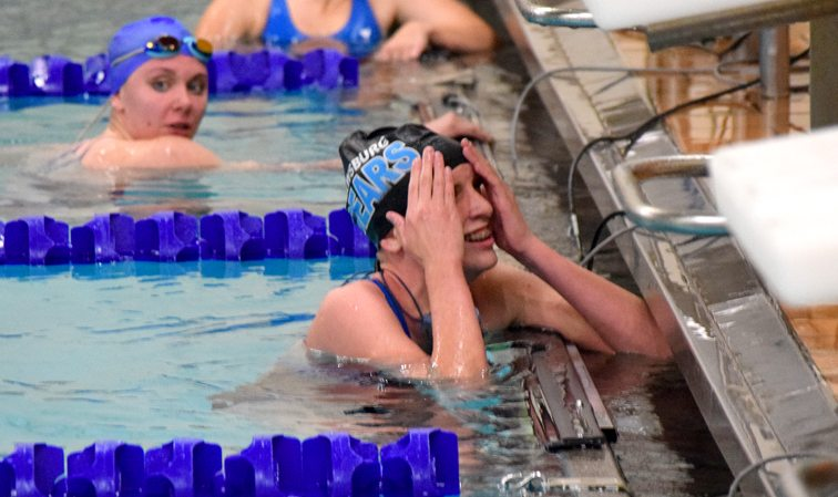 Frewsburg's Madison Kramer, left, had plenty to smile about Thursday night as she won two events, including setting a school record in the 400-meter freestyle, in the Bears' narrow team win over Panama. Photo by Kristy Kramer