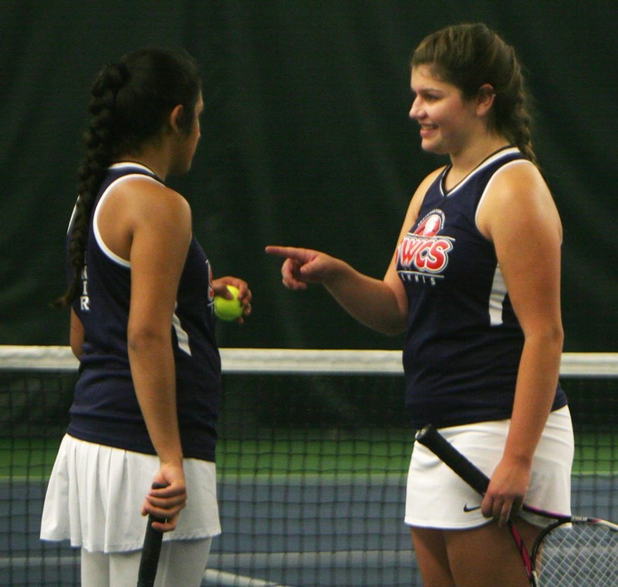 Southwestern's Hiba Munir, left, and Olivia Persia chat during a break in their doubles match in Thursday's Chautauqua-Cattaraugus Athletic Association Tennis Tournament at the Lakewood YMCA. P-J photo by Scott Kindberg