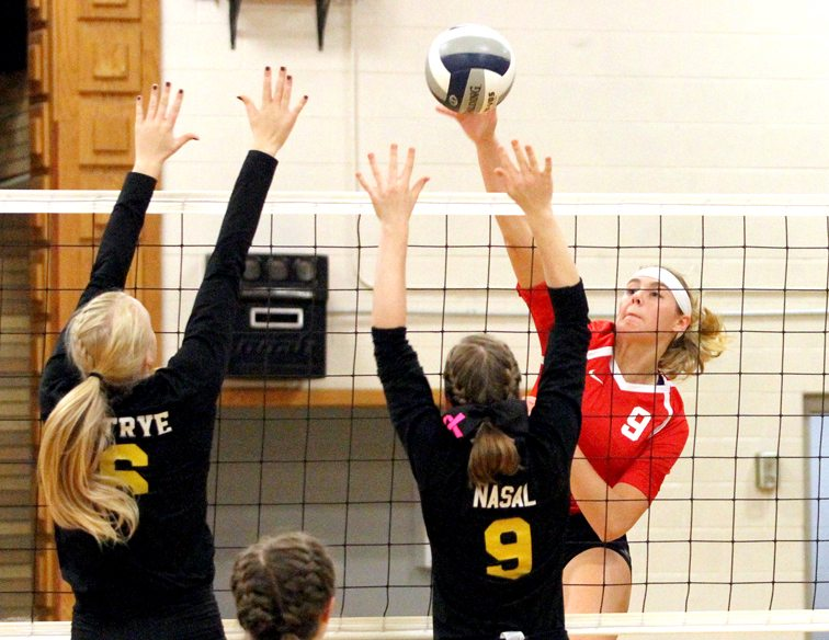 Cassadaga Valley's Jenna Caskey (right) tries to hit through the double block put up by Forestville's Brooke Ostrye, left, and Rhianna Nasal, middle. P-J photo by Lisa Monacell