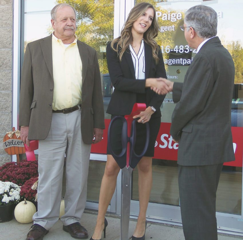 A new business was lauded recently during the grand opening of a State Farms Insurance agency on Washington Street in Jamestown. From left are Lee Harkness of the Jamestown Community Chamber of Commerce, Paige Foriska, State Farm Insurance agent, and Jamestown Mayor Sam Teresi.  P-J photo by Katrina Fuller