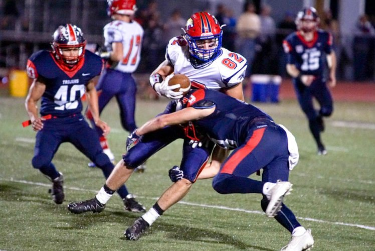 Southwestern's Brian Burns tackles Cassadaga Valley/Falconer's Adam Goot during Friday night's Class C South game at Charles A. Lawson Field. P-J photo by Chad Ecklof