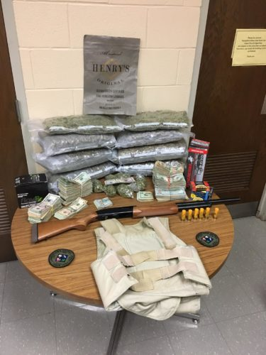 More than 15 pounds of marijuana and $47,000 in cash were seized Friday following an investigation into the illegal sales of drugs in Jamestown. A Jamestown man was charged following the execution of a search warrant.  Photo by the Jamestown Police Department