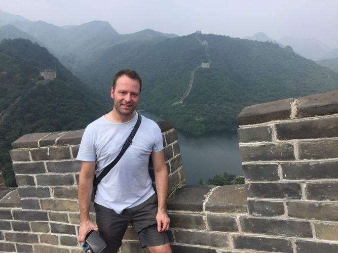 Chris Babbage, a Jamestown native, has found success across the U.S. and internationally as a music director and conductor in various off-Broadway productions. Babbage is pictured conducting a pit orchestra at the Tuacahn Center for the Arts in Utah, and atop the Great Wall of China. Submitted photo