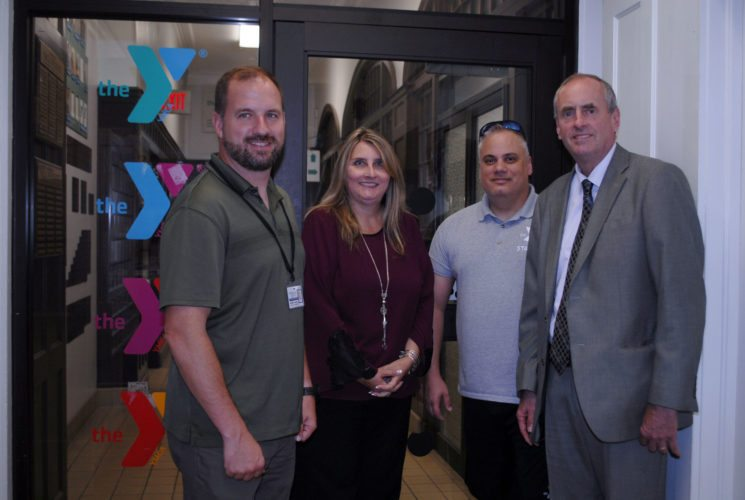 Pictured, from left, are Greg Carlson, the director of the Chautauqua County Veterans Service Agency; Cindy Reidy, the program coordinator for the Pfc. Joseph Dwyer Group; Christopher Blakeslee, the marketing and development director for the Jamestown Area YMCA; and Mark G. Eckendorf the chief executive officer, in the Jamestown Area YMCA's downtown branch lobby area. A partnership was formed between the Dwyer Group (VA) and the YMCA to help facilitate programing and support services for veterans across Chautauqua County because of funds appropriated by Sen. Cathy Young.