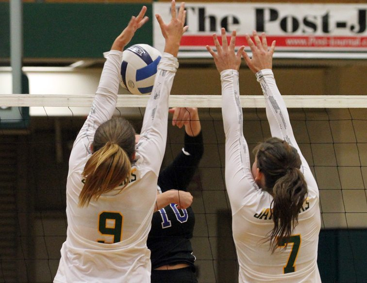 SallyAnne Rudny (9) and Kaylin Brumagin (7) team up for a block. P-J photo by Lisa Monacelli