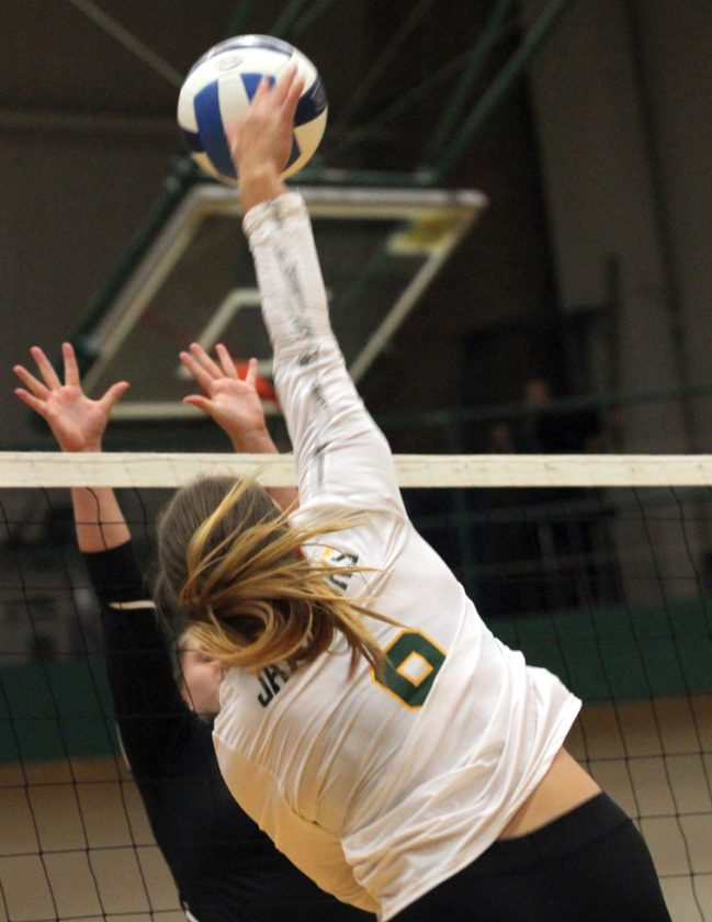 SallyAnne Rudny finishes off a spike. P-J photo by Lisa Monacelli