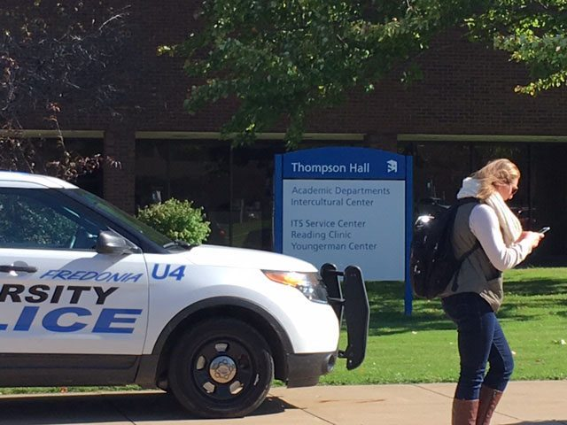A bomb threat forced the evacuation of Thompson Hall at SUNY Fredonia on Tuesday afternoon. The threat was later unfounded after K-9 units searched the building.  Photo by John D'Agostino