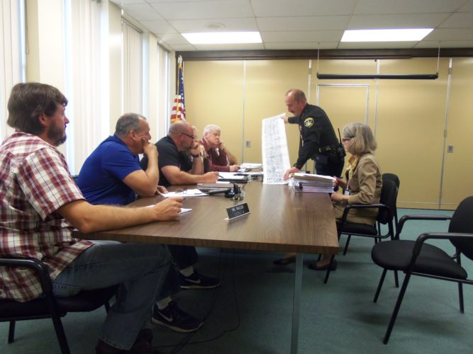 Chautauqua County Sheriff Joe Gerace showed legislators an example of what every shift and time-off slot at the Chautauqua County Jail looks like on paper for the last year at Wednesday's Public Safety Committee meeting.  P-J photo by Katrina Fuller