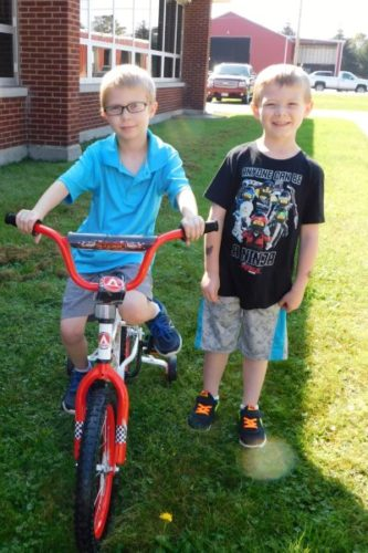 Noah Larsen, left, and Camden Becker are pictured. The two Temple Elementary students completed the summer reading challenge and were both in the running to win a donated bike.  Submitted Photo