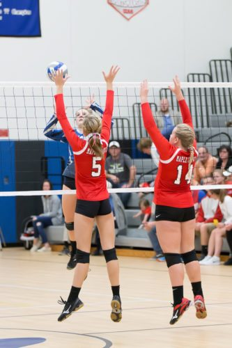 Maple Grove's Maddie Welsh (5) and Alyssa Steen (14) go up for a block. Submitted photo