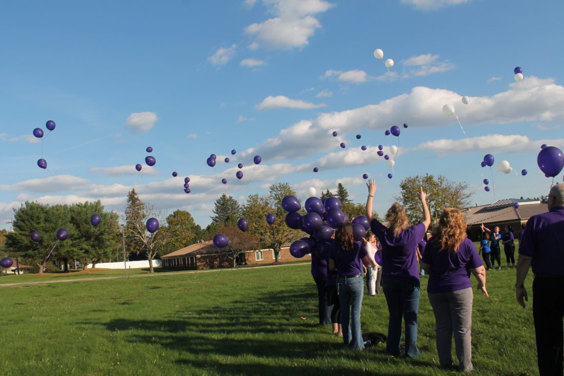 Balloons were released on Thursday to raise awareness on domestic violence and remember Shari Robbins who was killed during a domestic violence incident last year.  P-J photos by Jordan W. Patterson