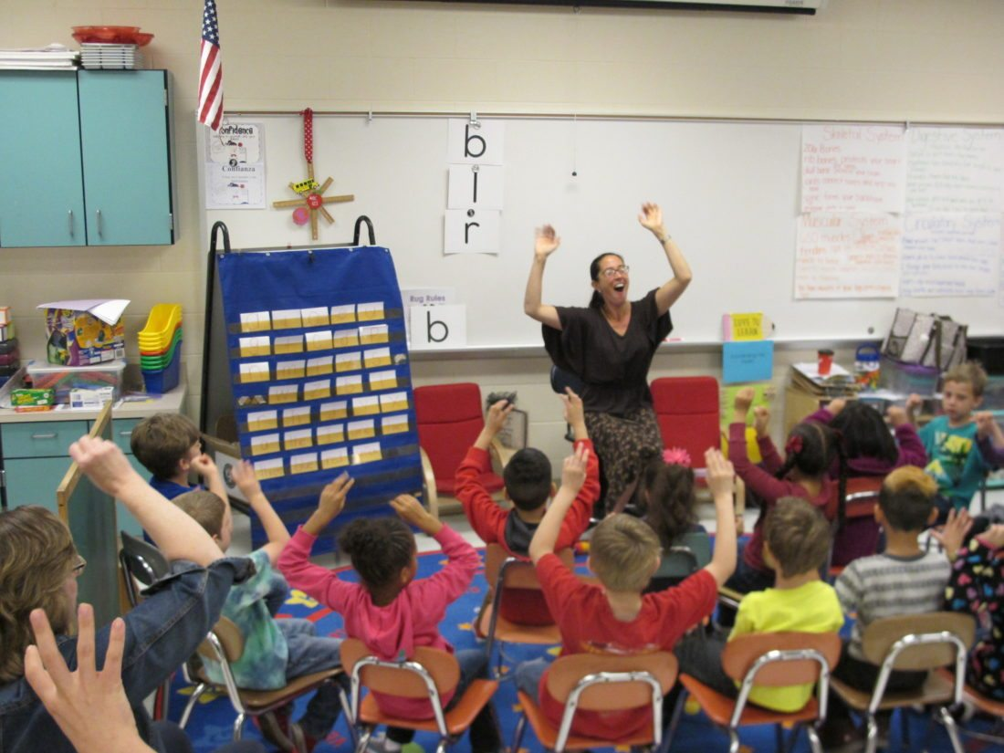Deborah Sunya Moore, Chautauqua Institution's vice president and director of marketing, leads first-graders at Love Elementary School in reading to a beat. P-J photo by Gavin Paterniti