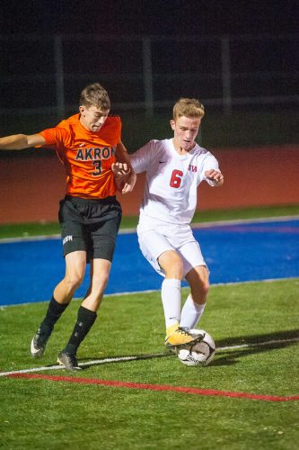 Southwestern's Marcus Kautzman, right, tries to keep the ball away from Akron's Tyler Whitbeck during Thursday night's Section VI Class B-2 quarterfinal soccer game. P-Jphoto  by Valory S. Isaacson
