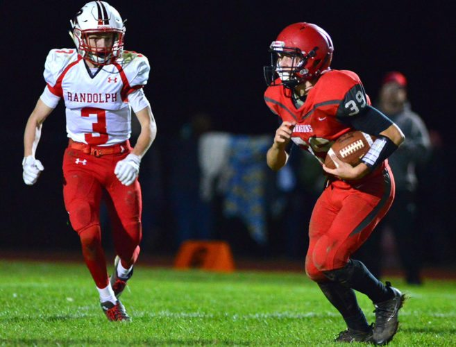 Maple Grove's Nash Nelson (39) attempts to get away from Randolph/Frewsburg's Tyler Hind (3) during Friday's Section VI Class D quarterfinal on Dutch Hollow Road. P-J photo by Scott Reagle
