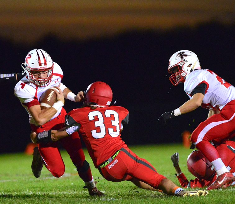 Maple Grove's Taige Jones (33) tackles Randolph/Frewsburg's Rocco Oliverio (4) during Friday's Section VI Class D quarterfinal on Dutch Hollow Road. P-J photo by Scott Reagle