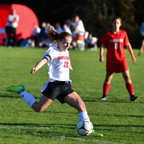 Maple Grove's Adri Carlson scores one of her three goals in the Red Dragons' Section VI Class C quarterfinal win over Randolph on Friday on Dutch Hollow Road. P-J photo by Scott Reagle