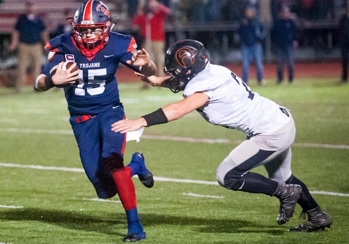 Southwestern's Cole Snyder (15) attempts to get away from Akron's Millard Young (23) during Friday night's Section VI Class C quarterfinal game at Charles A. Lawson Field. P-Jphoto by Valory S. Isaacson