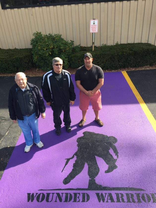 Carl Olander, commander of the Celoron Legion; Vern Brown, manager of the Celoron Legion; and George Patti, owner of Signature Paving & Sealcoating Inc. are pictured standing in the new Wounded Warriors parking space outside the Celoron Legion. Photo by Mallery Rockwell