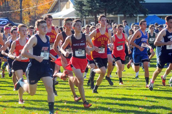 Southwestern's Dagon Bryant, left, and Maple Grove's Michael Peppy, right, compete in the CCAA boys race Friday at Bemus Point Golf Club. P-J Photo by Jay Young