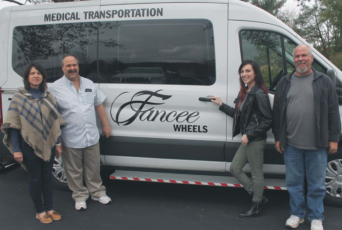 From left, Joann Barrus, Jeff Daversa, Destini Malta and Gary Mabee in front of a Fancee Wheels vehicle. Fancee Transportation, a medical transportation service, has opened a new, but similar service called Fancee Wheels. Fancee Wheels features 100 percent handicapped accessible vans that will transport people in need.  P-J Photos by Jordan W. Patterson