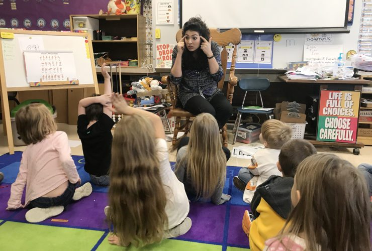 Bush School Counselor Alexandra Peterson talks with kindergarten students about responsibility as part of her character education lessons.