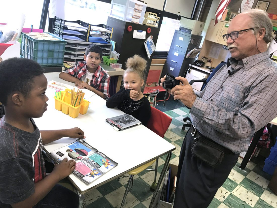 David Troxell videotaped Bush Elementary School school third grader Javon'tae Hampton about his life for a project with Cambodian students while fellow third graders, Jose Perez-Cruz and Amari Graham, wait their turn.