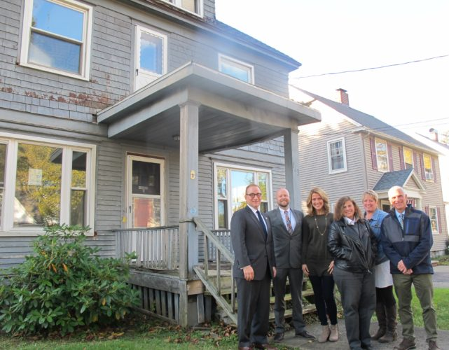 From left, Vince DeJoy, city development director; Peter and Lindsey Johnson, Beechview Avenue residents; Gina Paradis, Chautauqua County Land Bank Corporation executive director; Kimberly Ecklund, Jamestown City Councilwoman; and Anthony Dolce, Jamestown City Councilman; in front of a condemned house on Beechview Avenue that will be demolished. For a number of years, city and land bank officials, with input from Beechview Avenue residents, have been working to improve the neighborhood by dealing with housing issues at 113 Beechview Ave. P-J photo by Dennis Phillips
