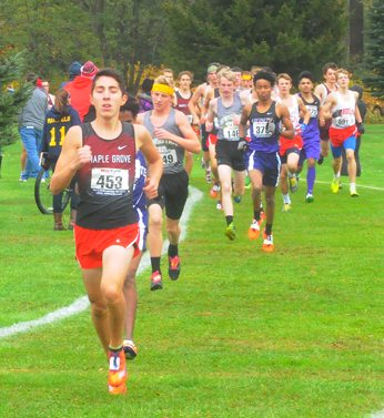 Maple Grove's Michael Peppy leads the way in the Class D boys race. P-J photo by Scott Kindberg
