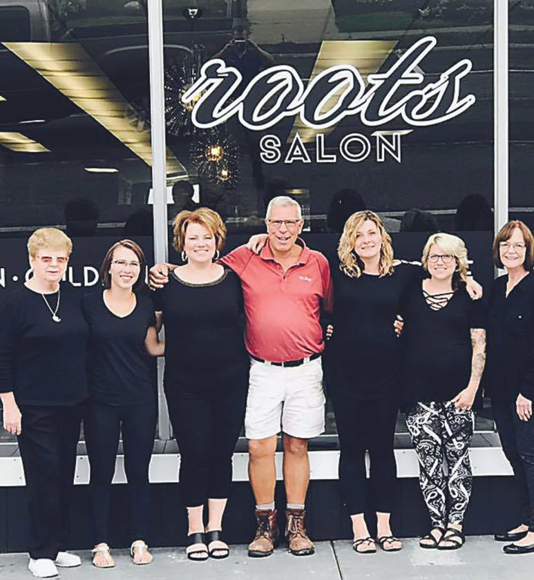 The team at Roots Salon was welcomed back with open arms to the downtown Falconer area by their landlord and the community at large. From left are Leslie Brown, Erin Roach, Stacy Howser, Brian Nelson, Amber Olrogg, Abbey Hildom and Pat Farmer.  Submitted photo