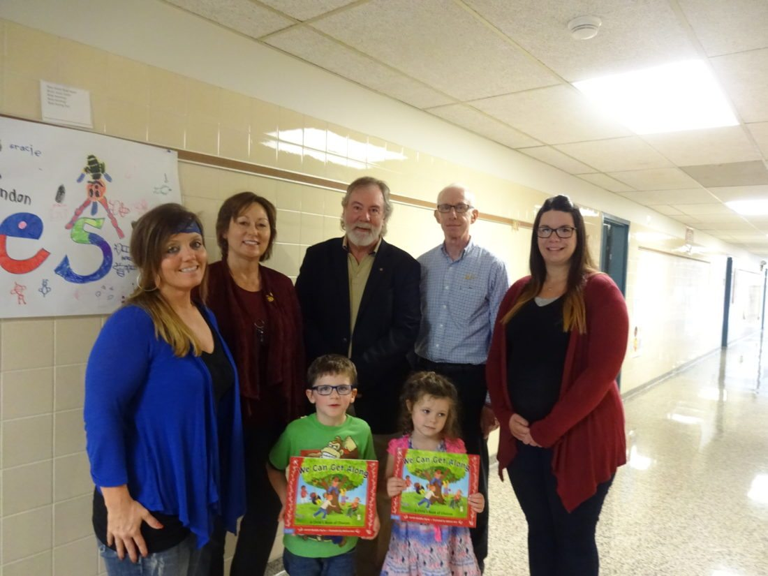"""Three former Ripley Central School District administrators, now retired and members of the Rotary Club of Westfield-Mayville, returned to the school on Oct. 6 for the purpose of representing their Rotary Club by speaking to kindergarten students and giving all of them copies of the book """"We Can Get Along"""" by Lauren Murphy Payne. Pictured are kindergarteners (front, from left) Liam Doner and Nelly Baker, and (back, from left) kindergarten teacher Shannon Rowe; former RCS Superintendent John Hamels, PhD.; former RCS Elementary Principal and Director of Special Education Jim Wakeman; former RCS High School Principal Sue Hammond; and kindergarten teacher Rebecca Humbert. Photo by Seneca Wilkinson Dikeman"""
