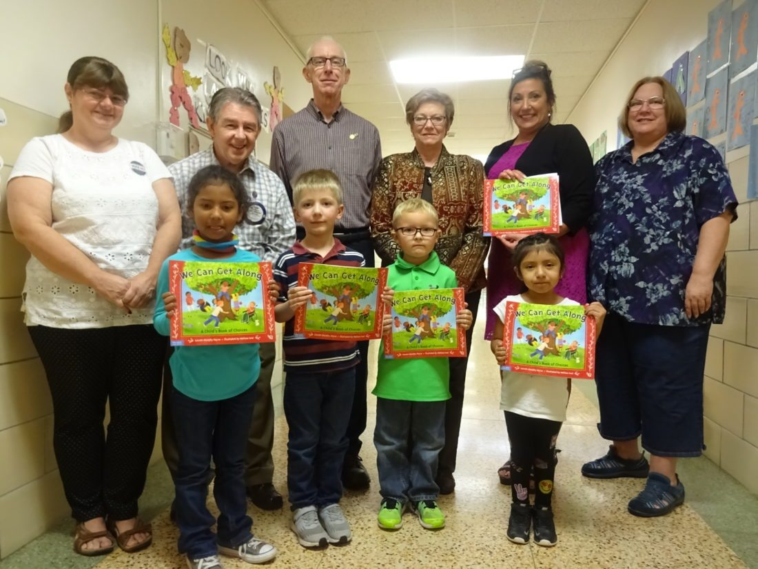"""On Oct. 10 all Brocton CSD kindergarten students were given copies of the book """"We Can Get Along,"""" written by Lauren Murphy Payne, by representatives of the Rotary Club of Westfield-Mayville. Among the children who received books to take home were (front, from left) Amyra Maisonet, Joshua Lanski, Ryder Carlton and Lydia Lopez. Attending the classroom presentations were (back, from left) BCS kindergarten teacher Susan Boettcher; Westfield-Mayville Rotary Club Youth Services Chair Dan Smith; Club District Grants and Foundation Chair Jim Wakeman; Club President Janese Berkhouse; BCS Elementary Principal Sandra Kopiczak; and BCS kindergarten teacher Dawn Bates."""