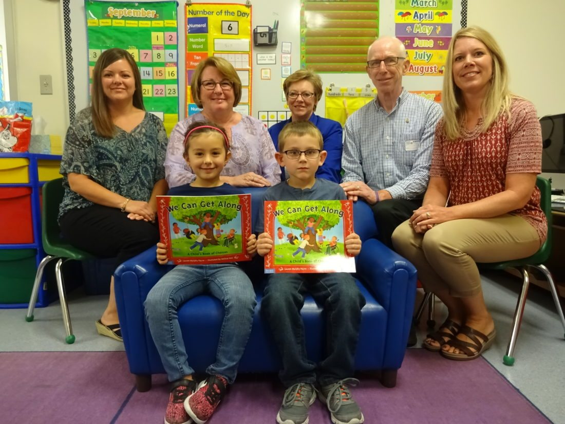 """Kindergarteners (front, from left) Emma Oehlbeck and Ethan Taylor were two of all Sherman Central School students of this grade level who received their own copies of the book """"We Can Get Along"""" by Lauren Murphy Payne from the Rotary Club of Westfield-Mayville on Sept. 28. Also pictured are (row two, from left) Sherman CSD kindergarten teacher Jennifer Benedetto; Westfield-Mayville Rotary Club President Elect Mary Swanson; Club President Janese Berkhouse; Club District Grants and Foundation Chair Jim Wakeman; and Sherman CSD kindergarten teacher Maureen Bogdanowicz."""