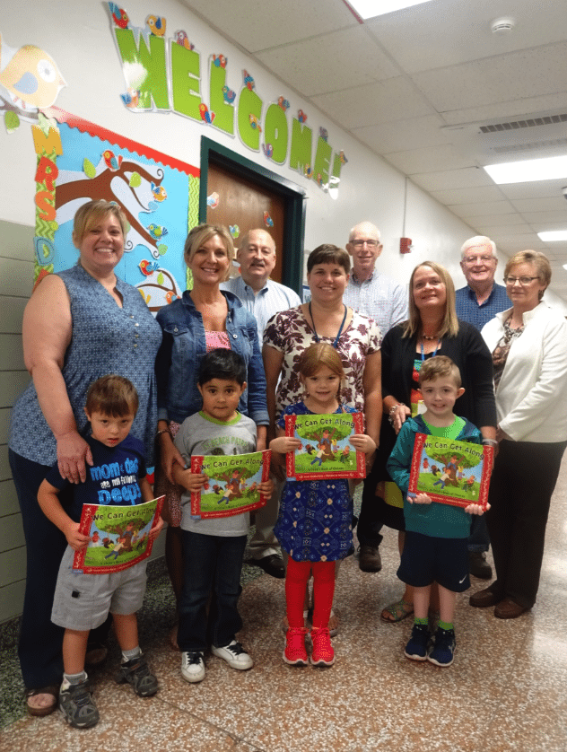 """Some of the 44 Westfield Academy & Central School kindergarten students who became the proud owners of """"We Can Get Along"""" books given by the Rotary Club of Westfield-Mayville on Oct. 3 were (front, from left) Liam Zakrajsek, Jose Sanabria, Savannah Stein and Greysson Lamphere. Also present were (row two, from left) WACS teachers Joan Clamp, Tamara Meyer, Kelly DeLand and Nancy Miller, and (row three, from left) Westfield-Mayville Rotary Club Treasurer Tracy Bennett; Club District Grants and Foundation Chair Jim Wakeman; Community Service Chair Tom Berkhouse; and President Janese Berkhouse."""